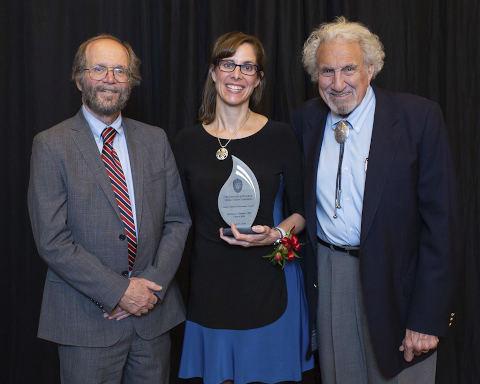 An alumnus receives an award