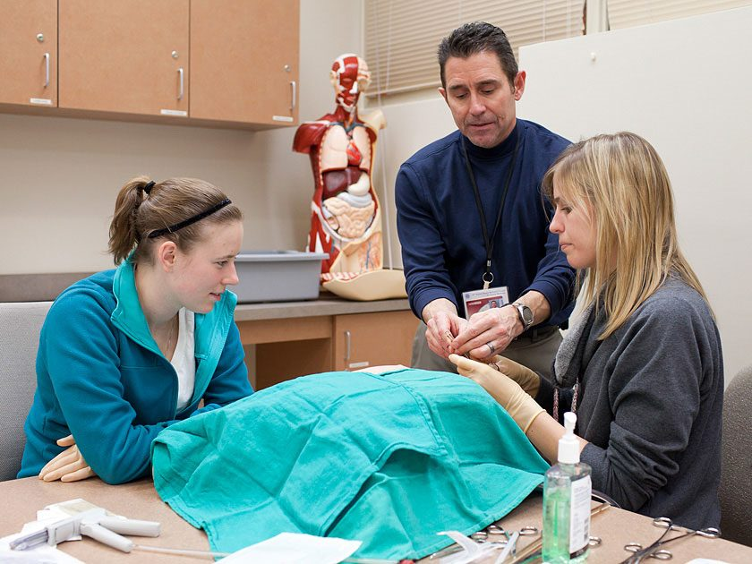 Physician assistant students learning clinical skills