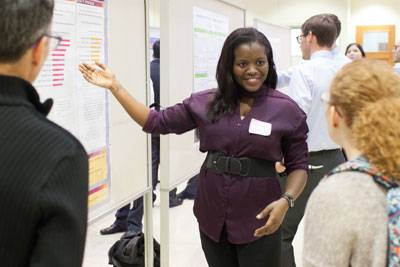 A medical student explaining her research