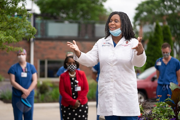 A doctor greets new medical students