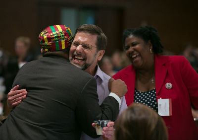 Attendees of a conference embrace