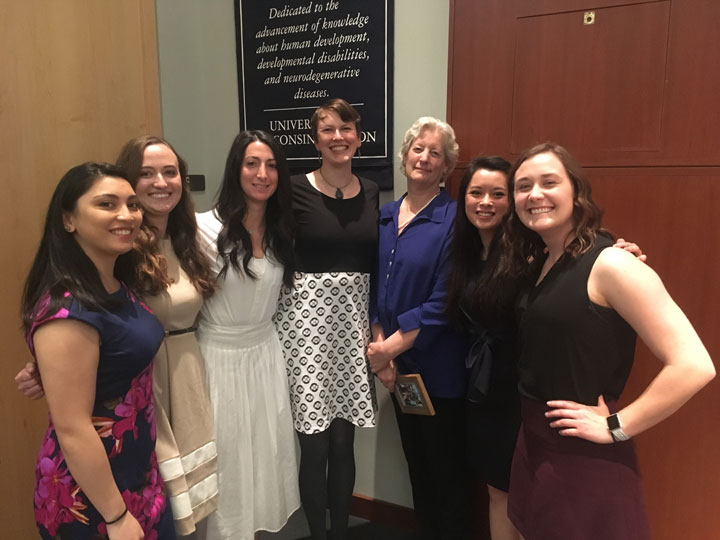 A group of genetic counseling students at graduation