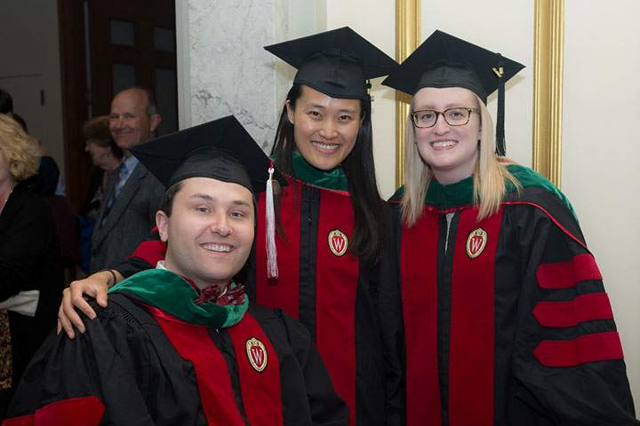 Three medical students at graduation
