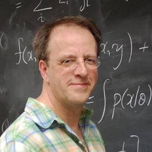 Michael Newton standing near a chalkboard