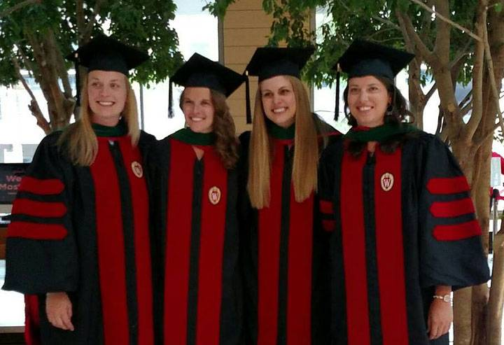 Four physical therapy students at graduation