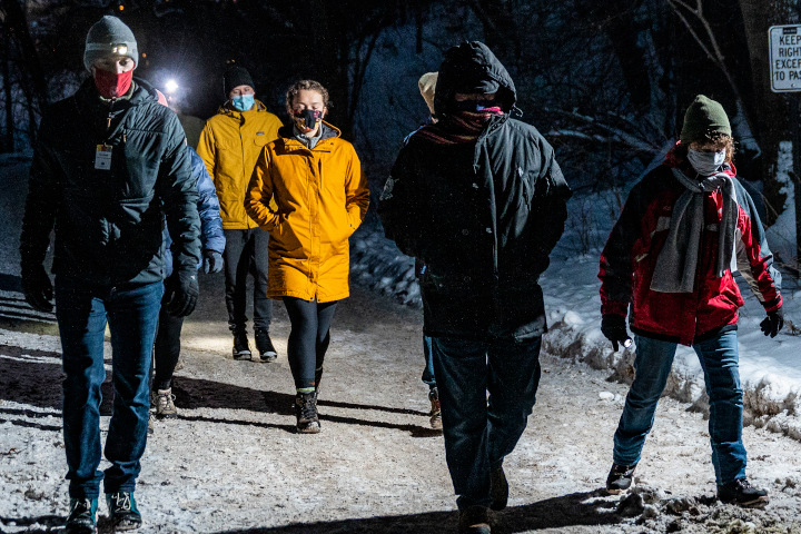A group of pedestrians wearing masks