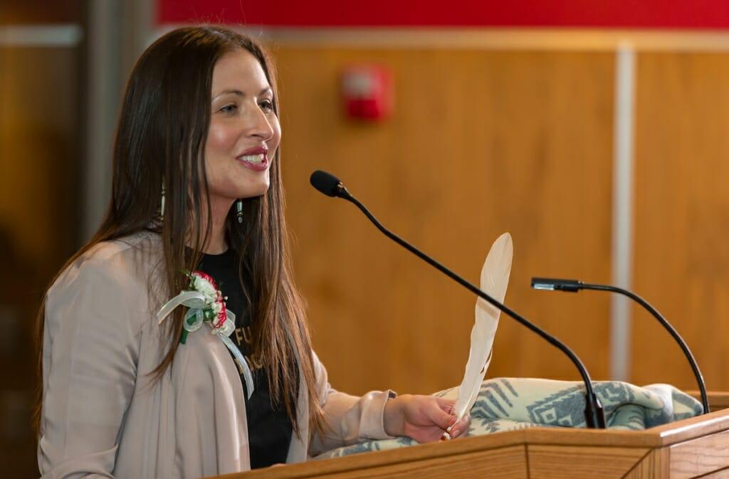 Melissa Metoxen speaking at a podium