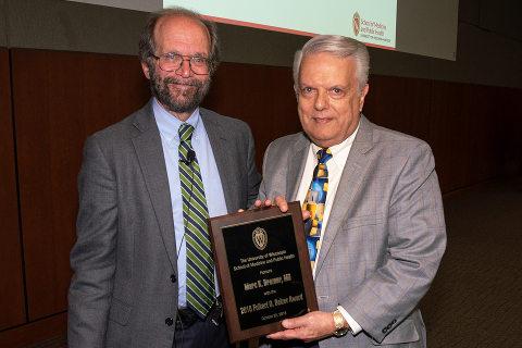 Marc Drezner accepts the Belzer Award