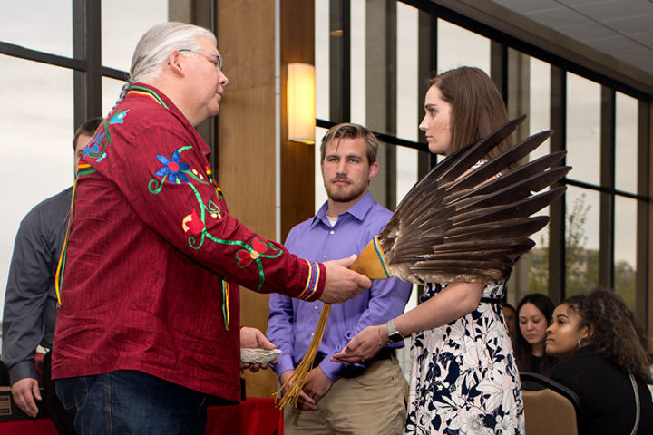 A student receives a native blessing