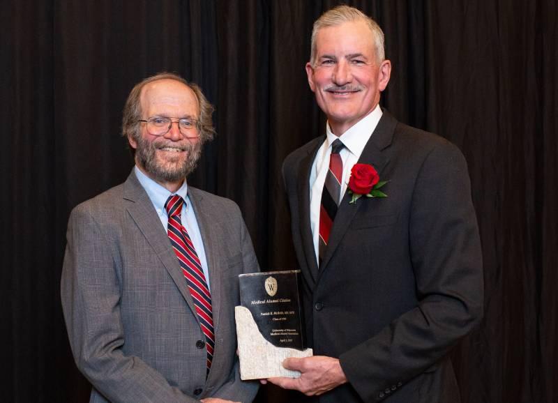 Robert Golden presenting Patrick McBride with an award