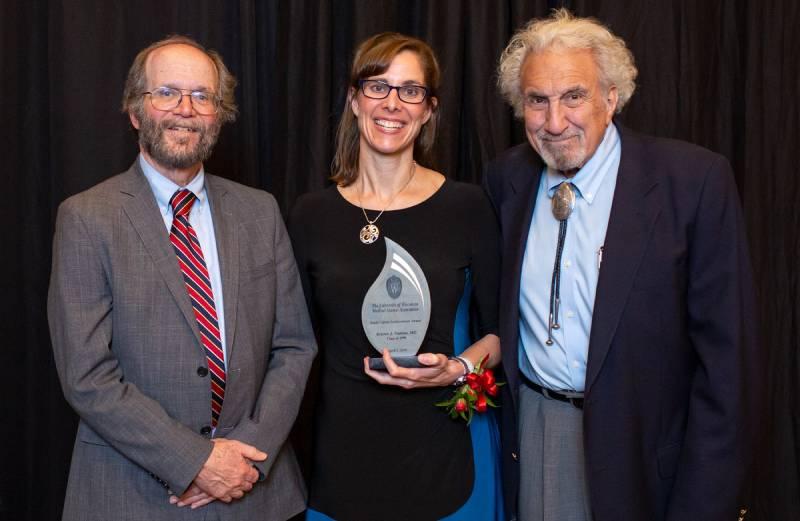 Robert Golden presenting Kristen Nadeau with an award