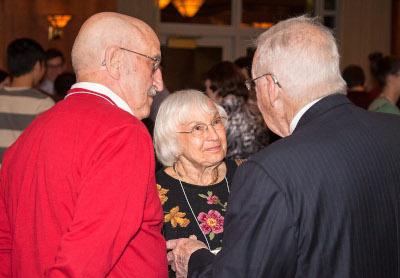 Left to right: Archie Budzak and Kathe Budzak talk with Louis Bernhardt