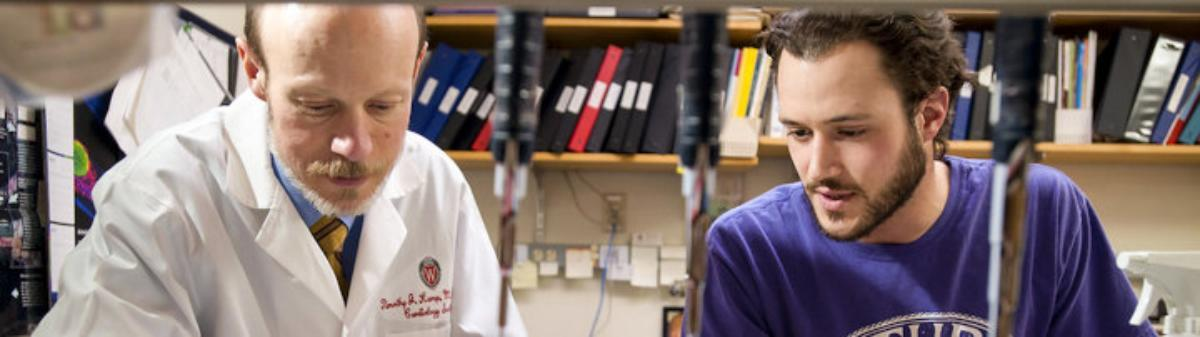 Timothy Kamp and a graduate student in a lab