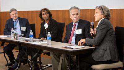 Four people leading a panel discussion