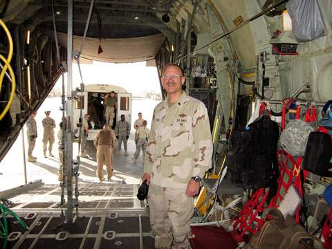 A soldier standing in a military cargo plane