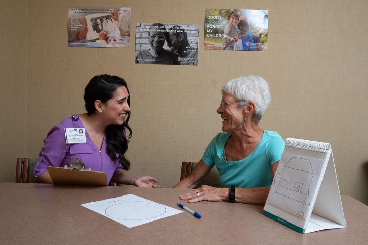 Susan Gruber completes a memory exam with Susie Fernandez de Cordova