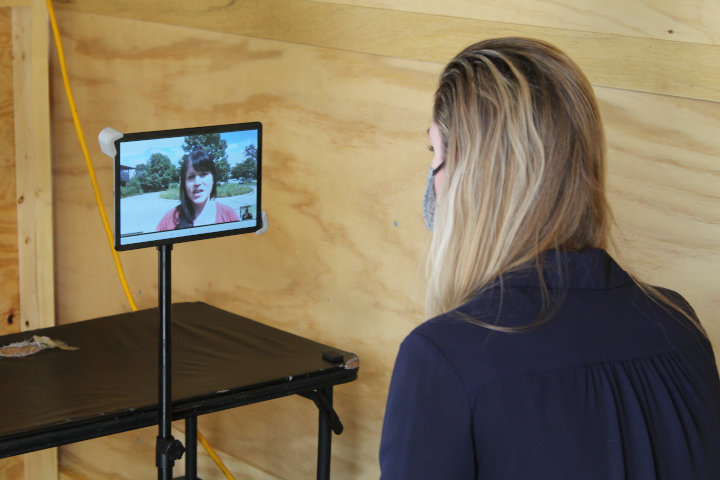 A nurse seeing a patient via telehealth technology